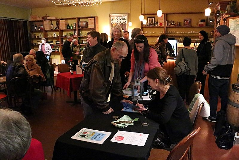 Sylvia Gray autographs copies of Ask The Ancients for guests
